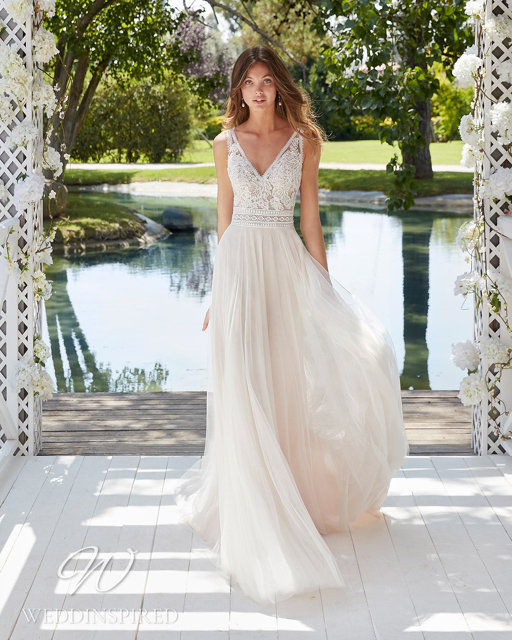 An Aire Barcelona 2021 blush lace and tulle A-line wedding dress