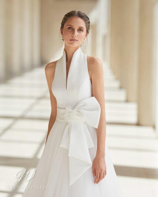 An Aire Barcelona 2021 halterneck A-line wedding dress with a bow