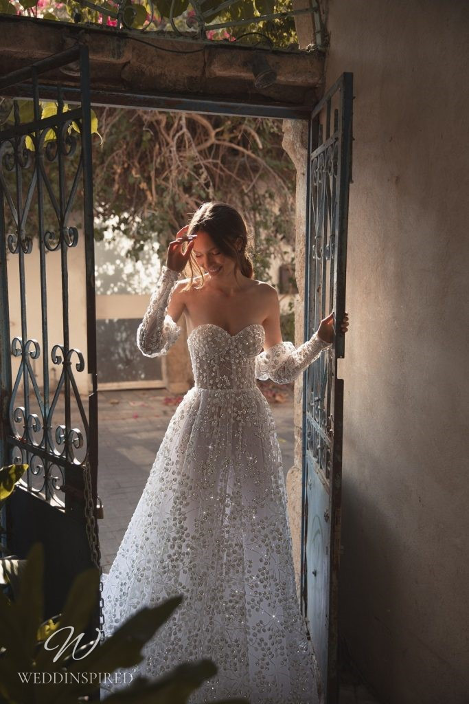 An Eden Aharon 2020 floral sparkly strapless mesh A-line wedding dress with detachable sleeves