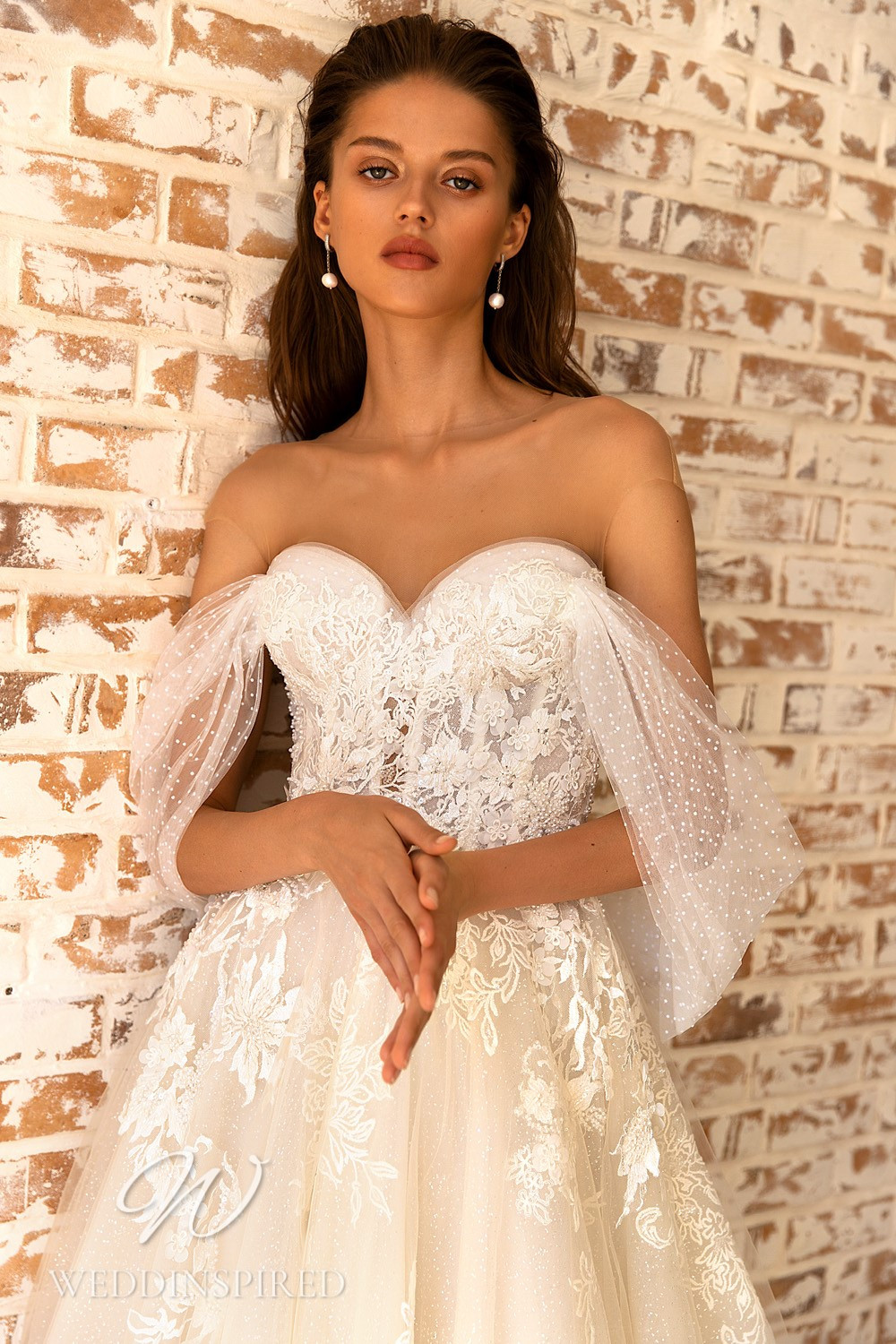 A WONÁ Concept 2021 blush lace and tulle off the shoulder A-line wedding dress