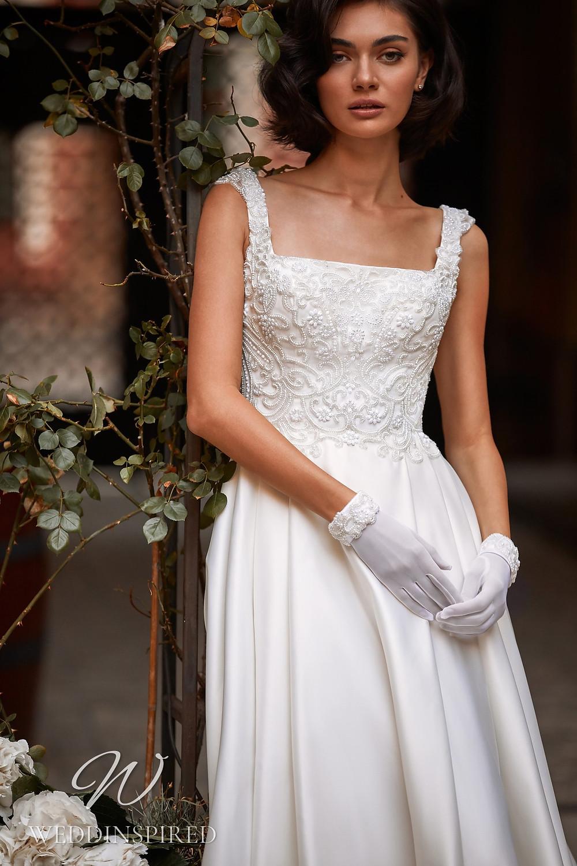 A Daria Karlozi 2021 lace and satin A-line wedding dress