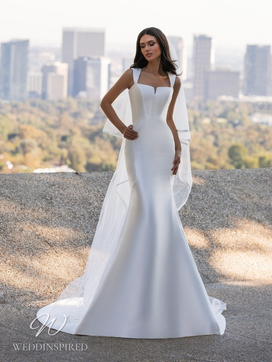 An Ashley Graham x Pronovias 2021 simple satin mermaid wedding dress with straps