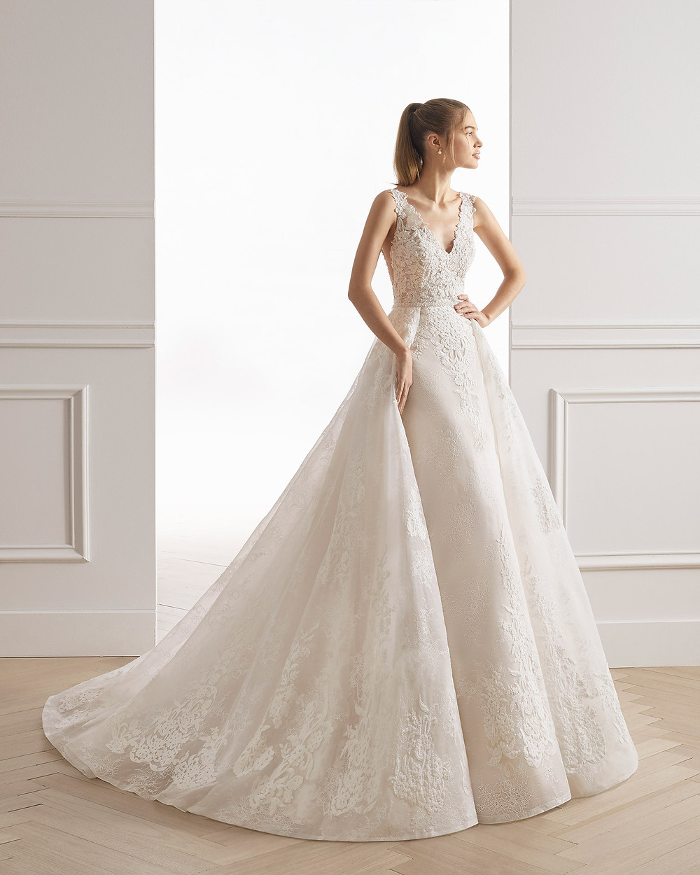 An Aire Barcelona 2020 romantic lace mermaid wedding dress with a detachable skirt and a v neckline