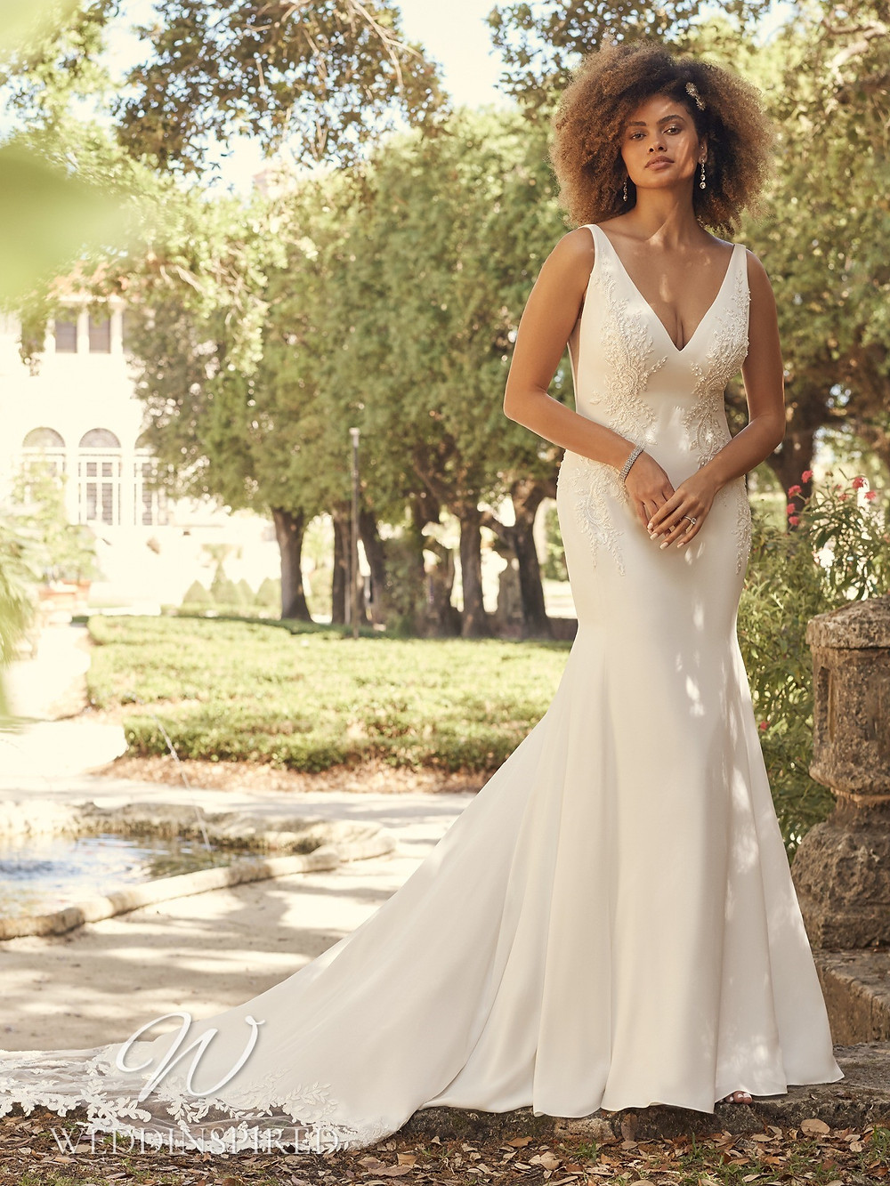A Maggie Sottero 2021 lace and satin mermaid wedding dress