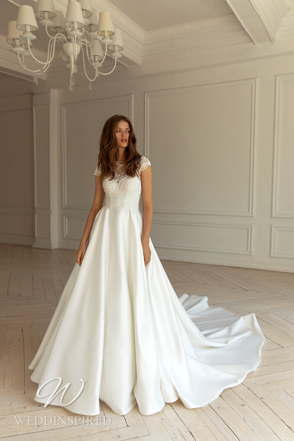 A WONÁ Concept 2021 lace and satin A-line wedding dress with cap sleeves