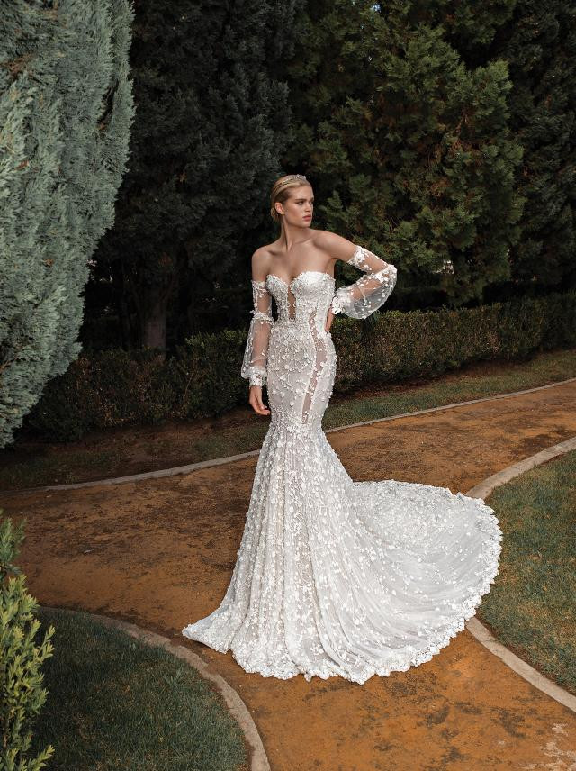 An off the shoulder, lace, mermaid wedding dress, with corset top and sweetheart neckline