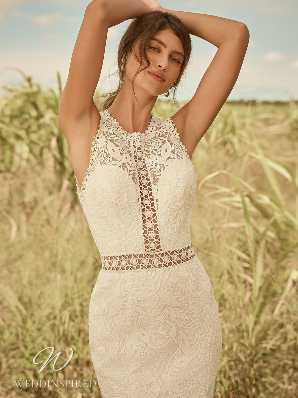 A Rebecca Ingram Spring 2021 ivory lace mermaid wedding dress with a high neckline and straps