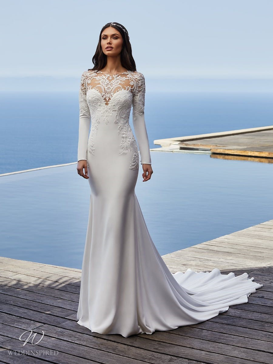 A Pronovias 2021 lace and crepe column wedding dress with long sleeves