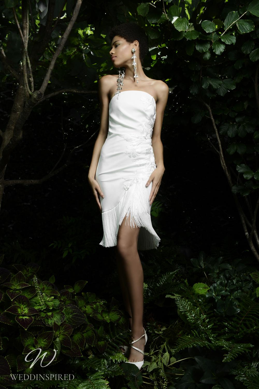 A Naeem Khan Fall 2021 fun strapless short wedding dress with fringe detail