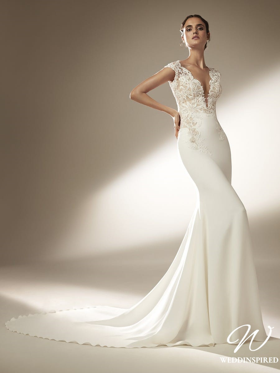 An Atelier Pronovias silk and lace sheath wedding dress with low v neckline and a train