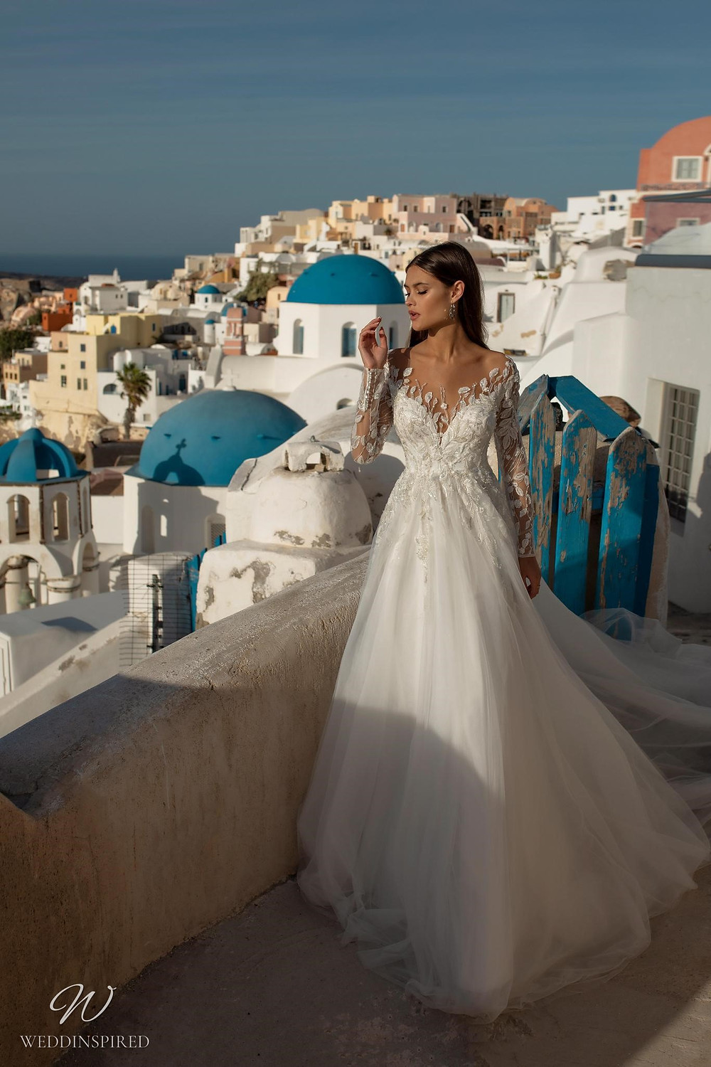 A Ricca Sposa romantic lace and tulle ball gown wedding dress with long lace illusion sleeves