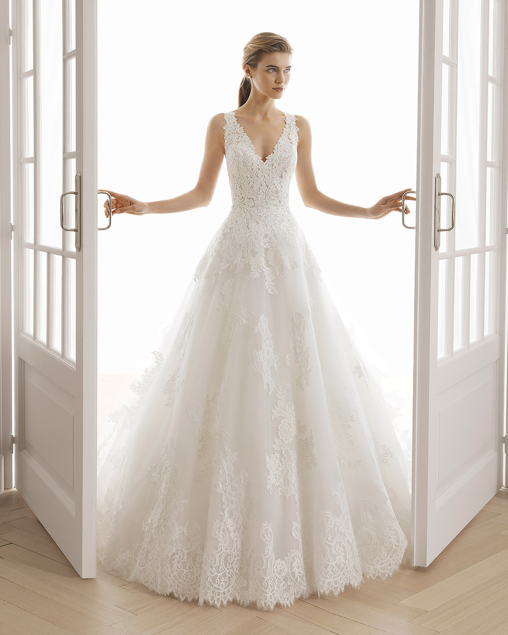 An Aire Barcelona 2020 romantic lace and tulle ball gown wedding dress with a v neckline