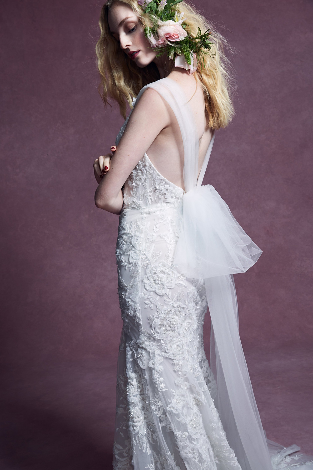 A Marchesa 2020 lace, mermaid wedding dress with tulle sleeves and ribbons