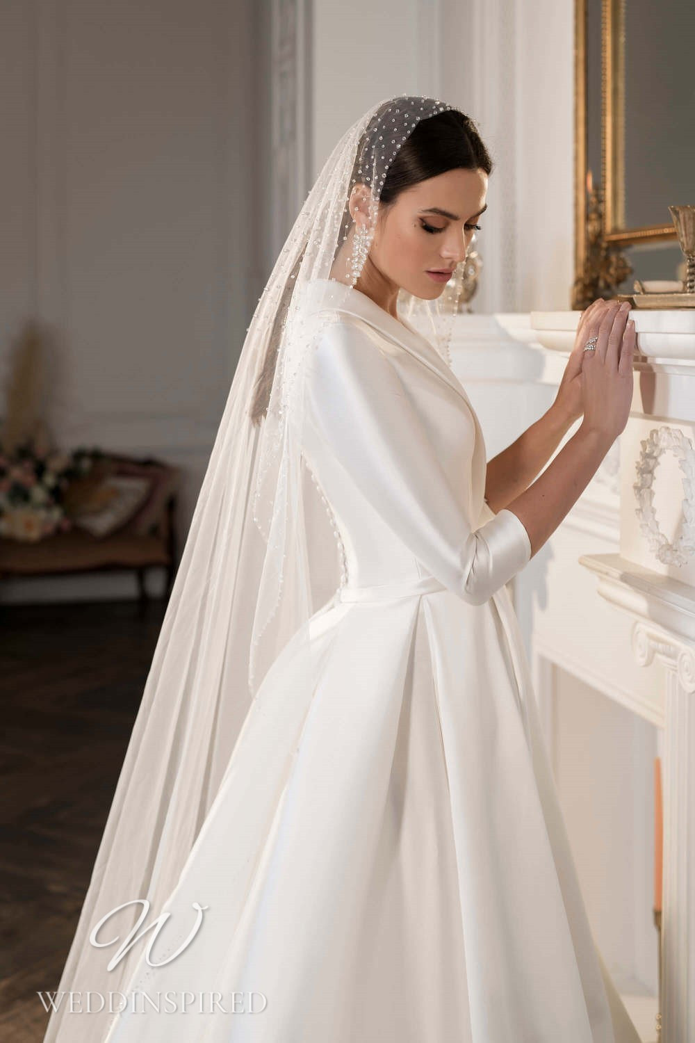 A Lussano 2021 satin A-line wedding dress with half sleeves