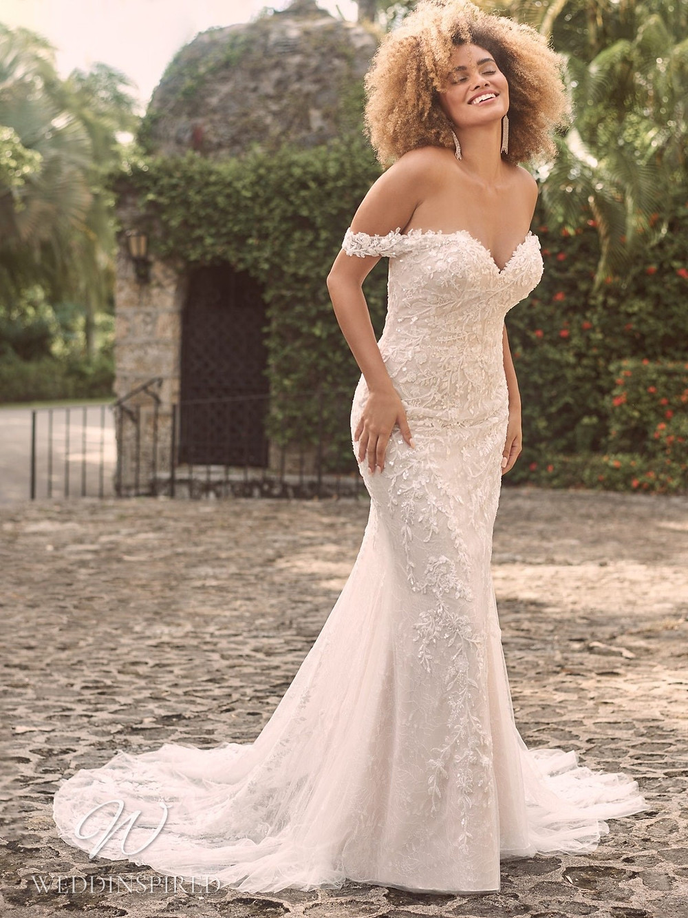 A Maggie Sottero Spring 2021 off the shoulder lace mermaid wedding dress