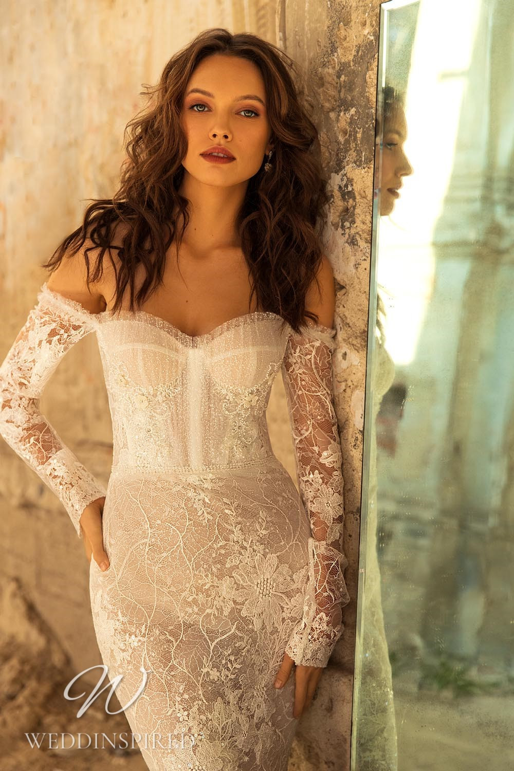 An Eva Lendel 2021 lace off the shoulder mermaid wedding dress with long sleeves