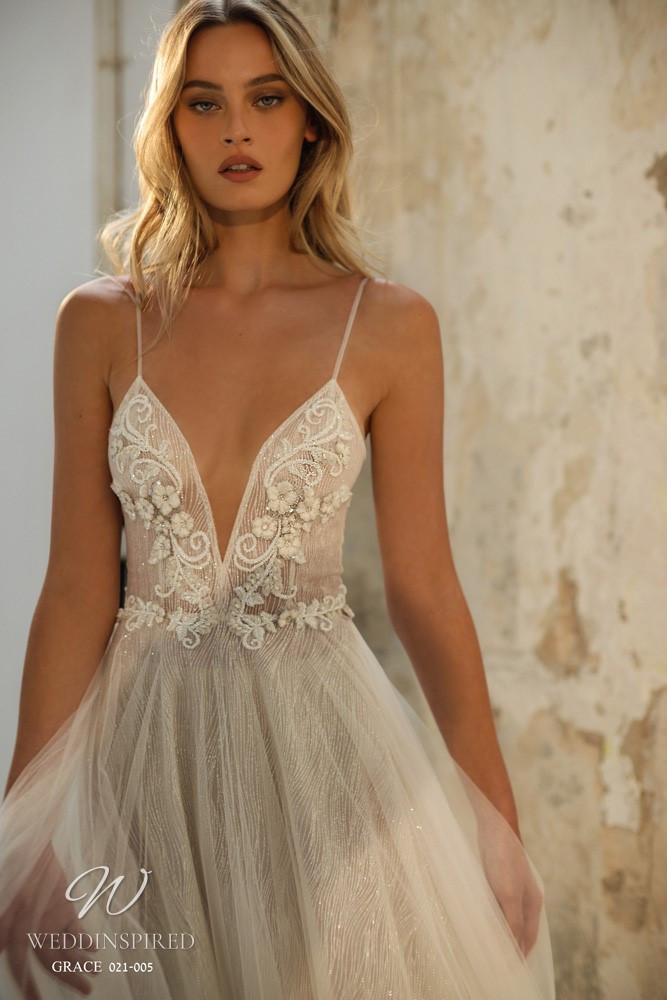A Gali Karten 2021 flowy A-line wedding dress with thin straps and a v neck