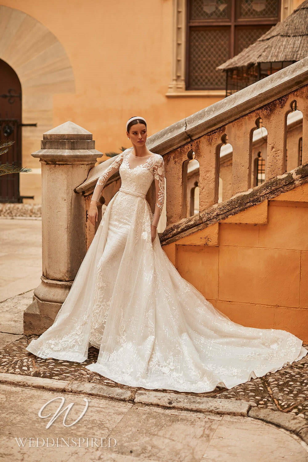 A Royal by Naviblue 2021 lace mermaid wedding dress with long sleeves and a detachable skirt