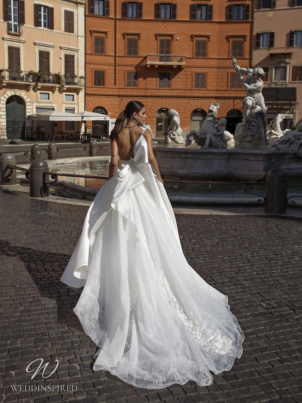 A Pinella Passaro silk satin ball gown wedding dress with a bow