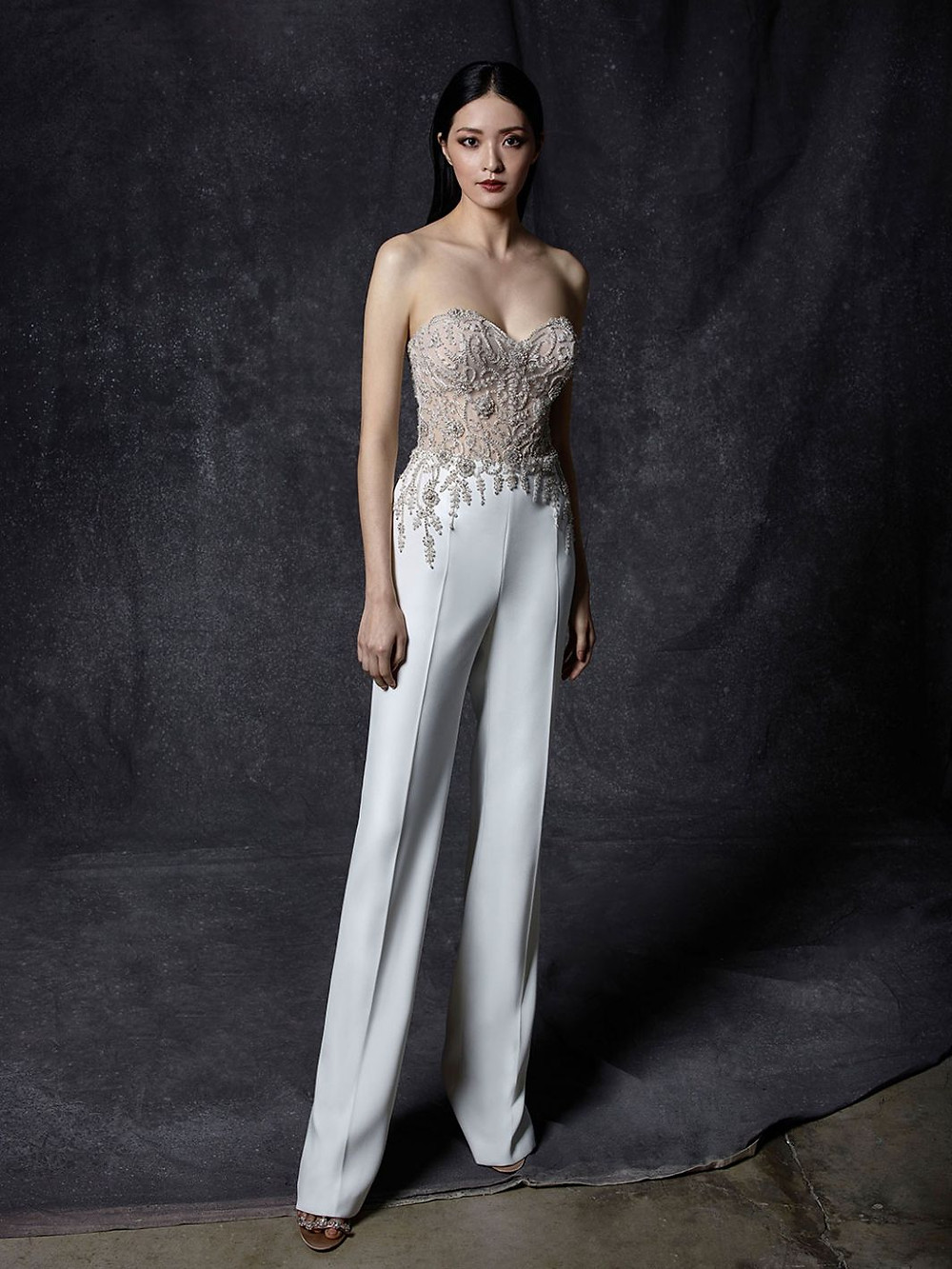 An Enzoani silk wedding jumpsuit with a lace bodice and sweetheart neckline