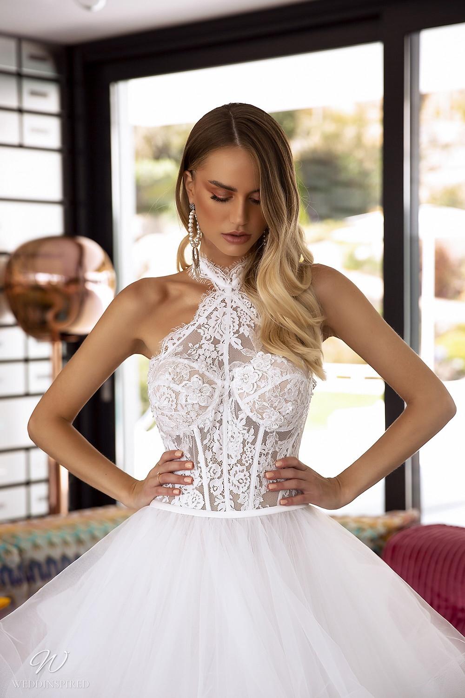 A Tina Valerdi halterneck lace and tulle princess ball gown wedding dress