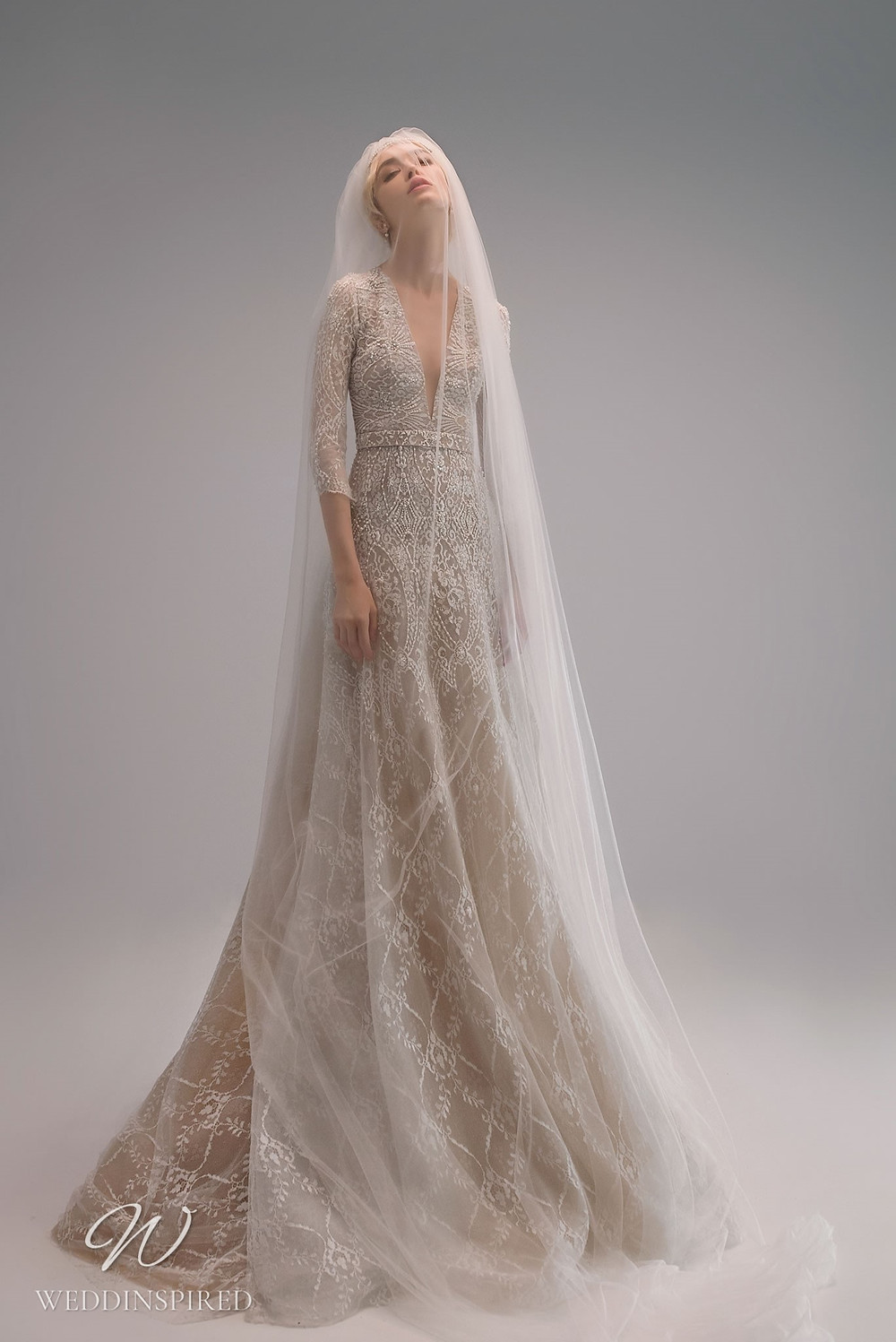 An Ersa Atelier 2021 A-line blush wedding dress with tulle, half sleeves, a v neck and beading