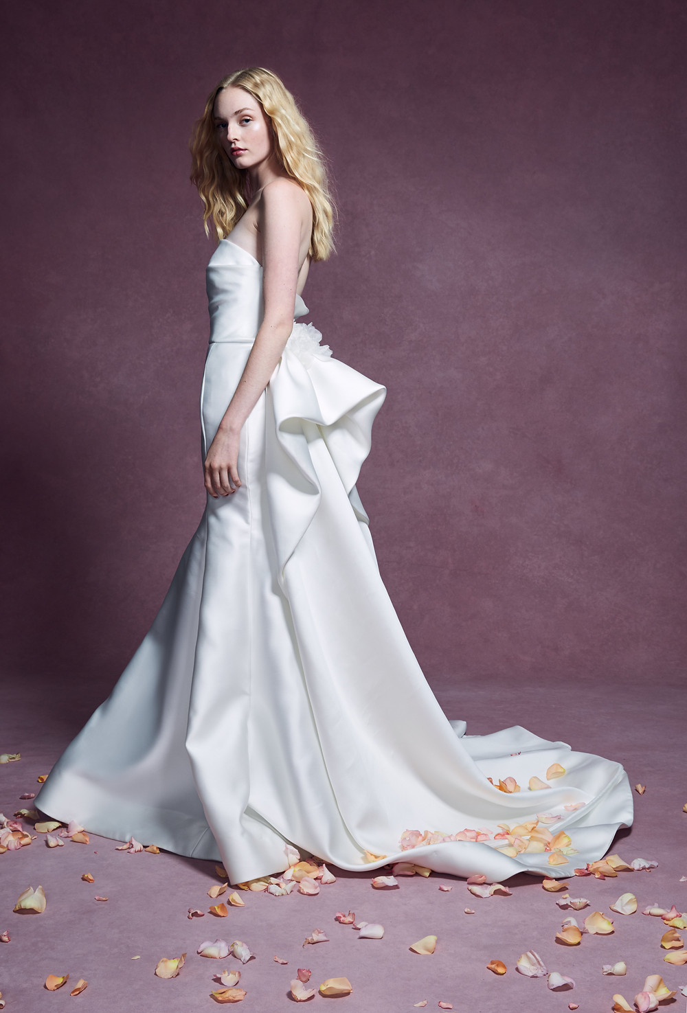 A Marchesa 2020 trumpet style wedding dress, with sweetheart neckline and a large bow