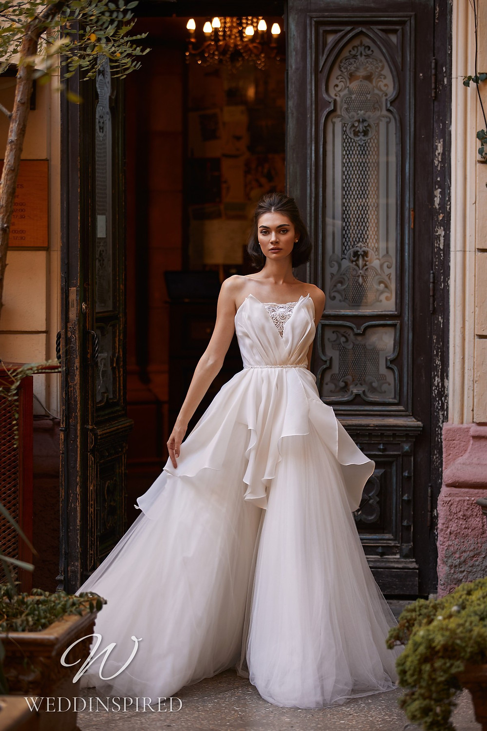A Daria Karlozi 2021 strapless tulle and satin A-line wedding dress