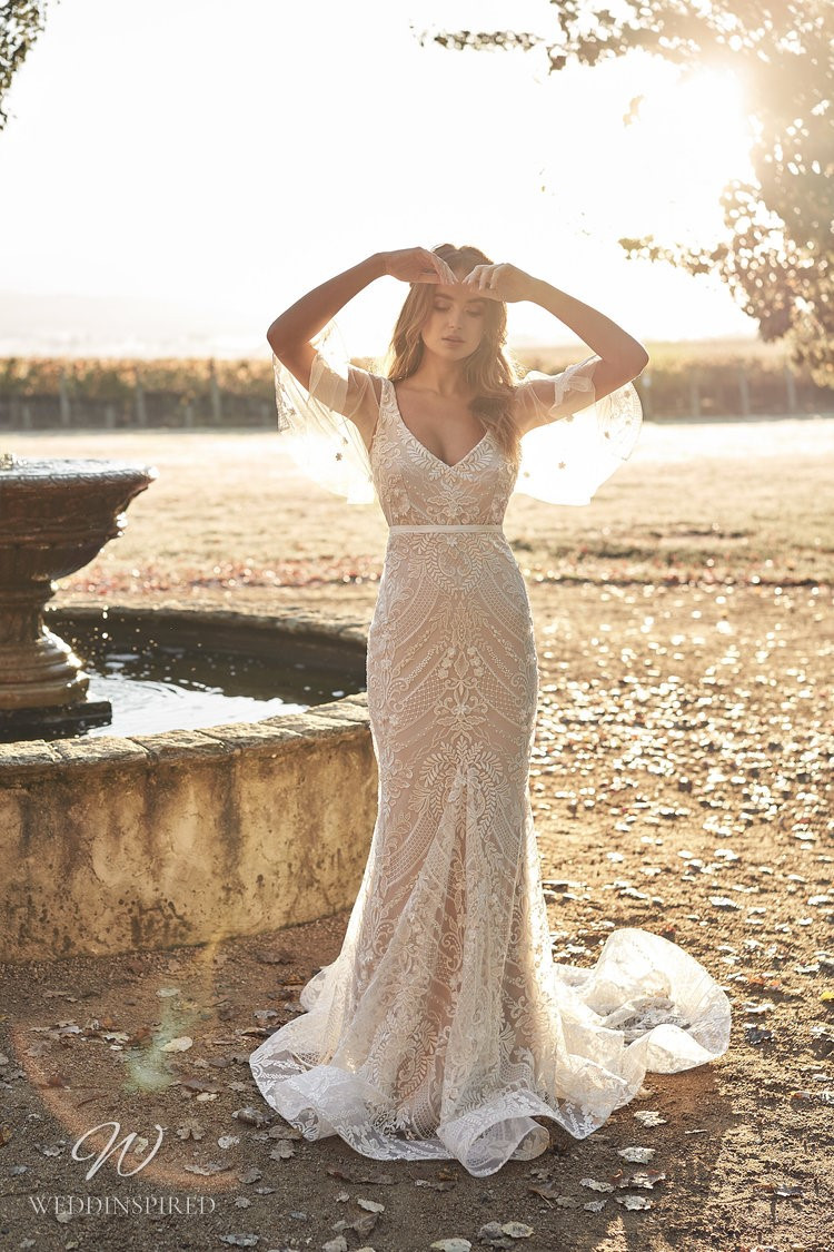 An Anna Campbell 2020 blush fitted lace, v neck wedding dress with draped tulle sleeves
