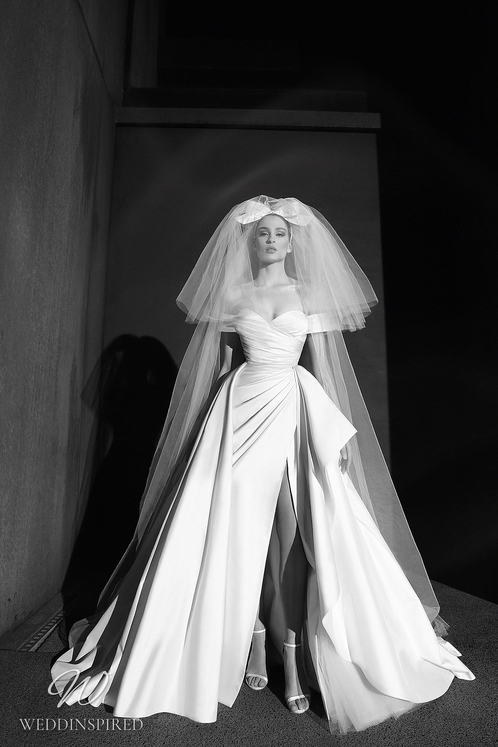 A Zuhair Murad Spring 2022 satin off the shoulder ball gown wedding dress with a slit