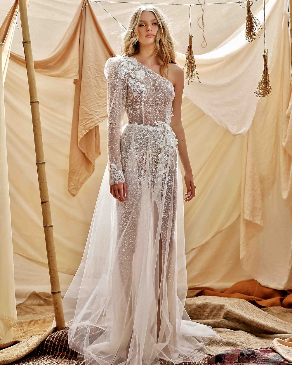 A Berta 2021 soft, flowy, one shoulder wedding dress with flowers and sparkles
