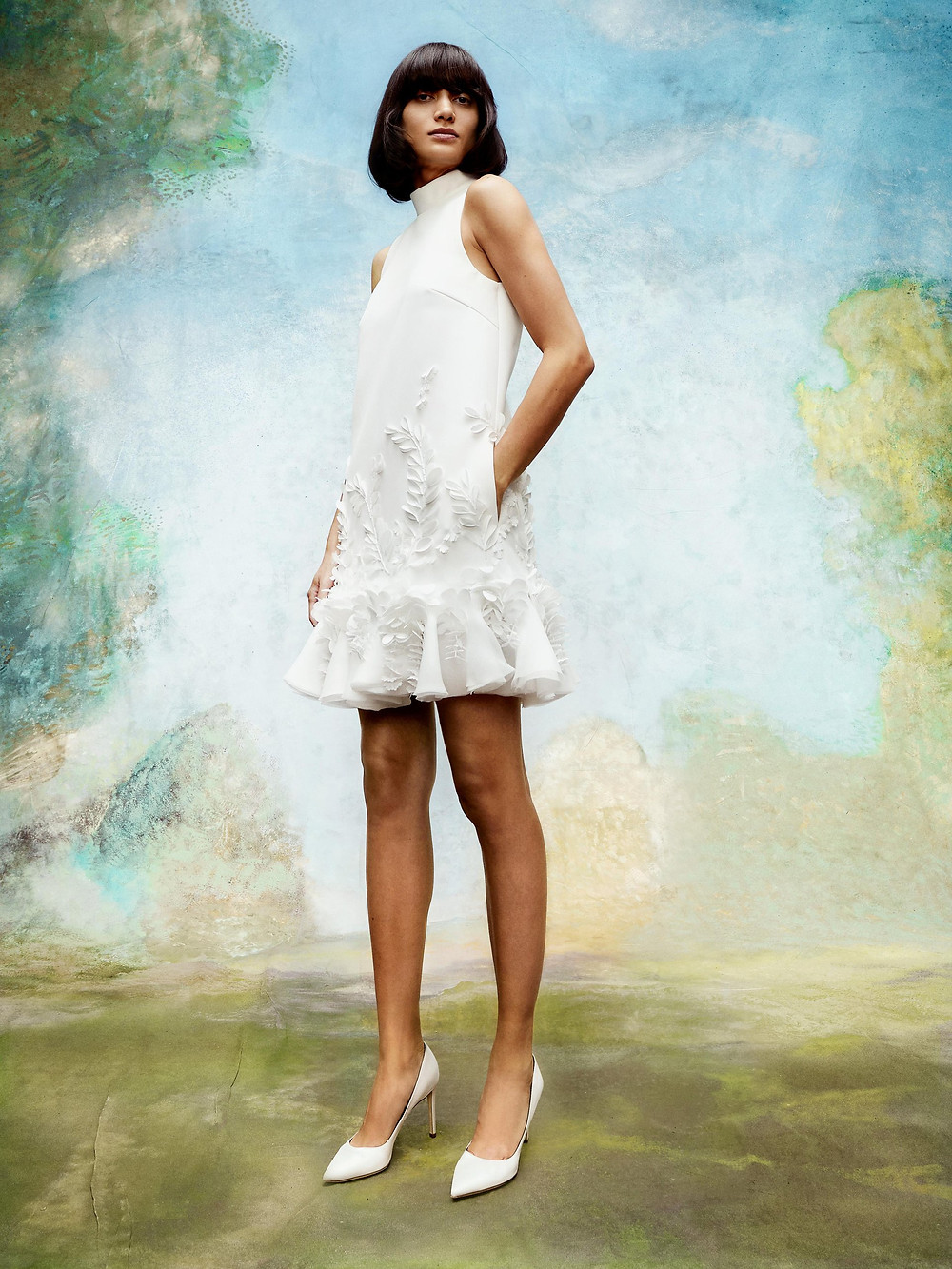 A Viktor & Rolf short crepe wedding dress with a high neck, ruffles and floral detail