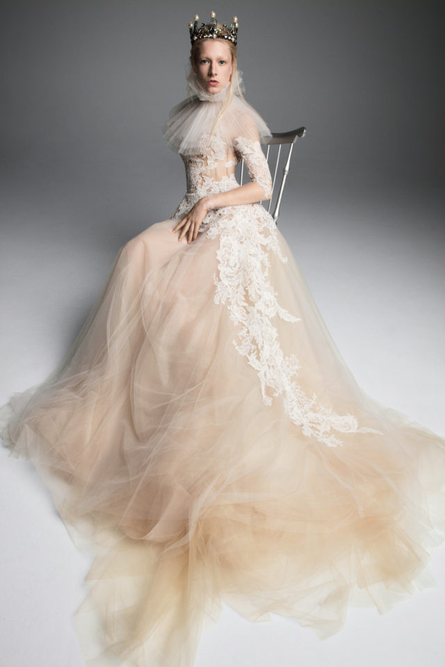 A Vera Wang blush, 3/4 sleeve, ball gown wedding dress, with lace and a tulle skirt