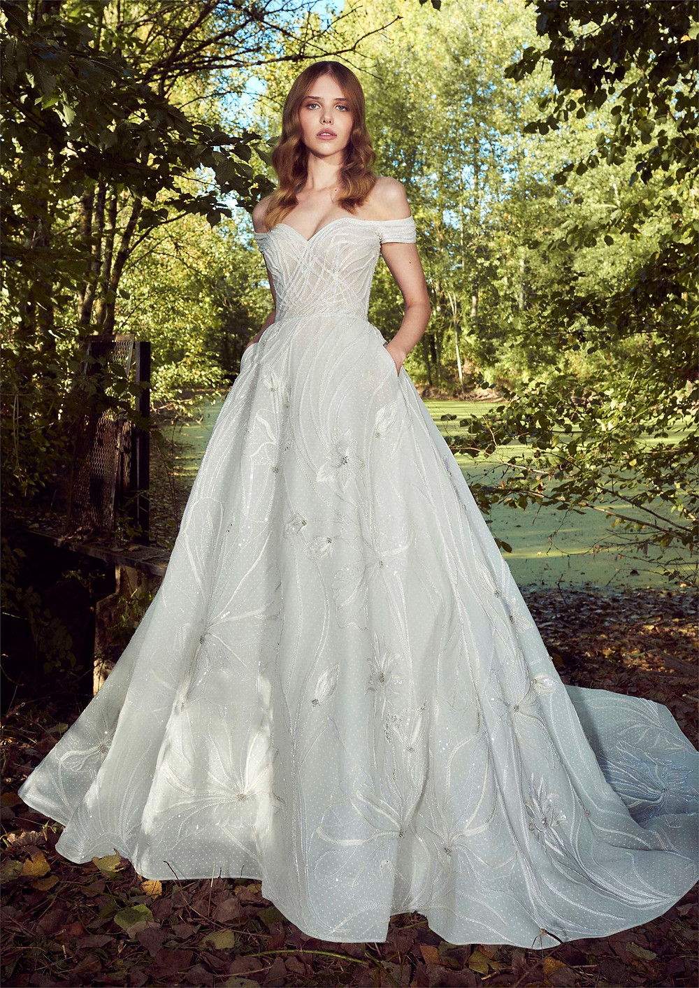 A Zuhair Murad off the shoulder ball gown wedding dress with pockets and a sweetheart neckline