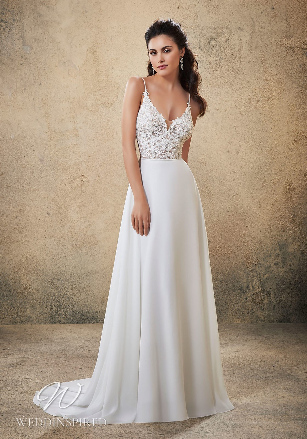 A Madeline Gardner lace and chiffon A-line wedding dress