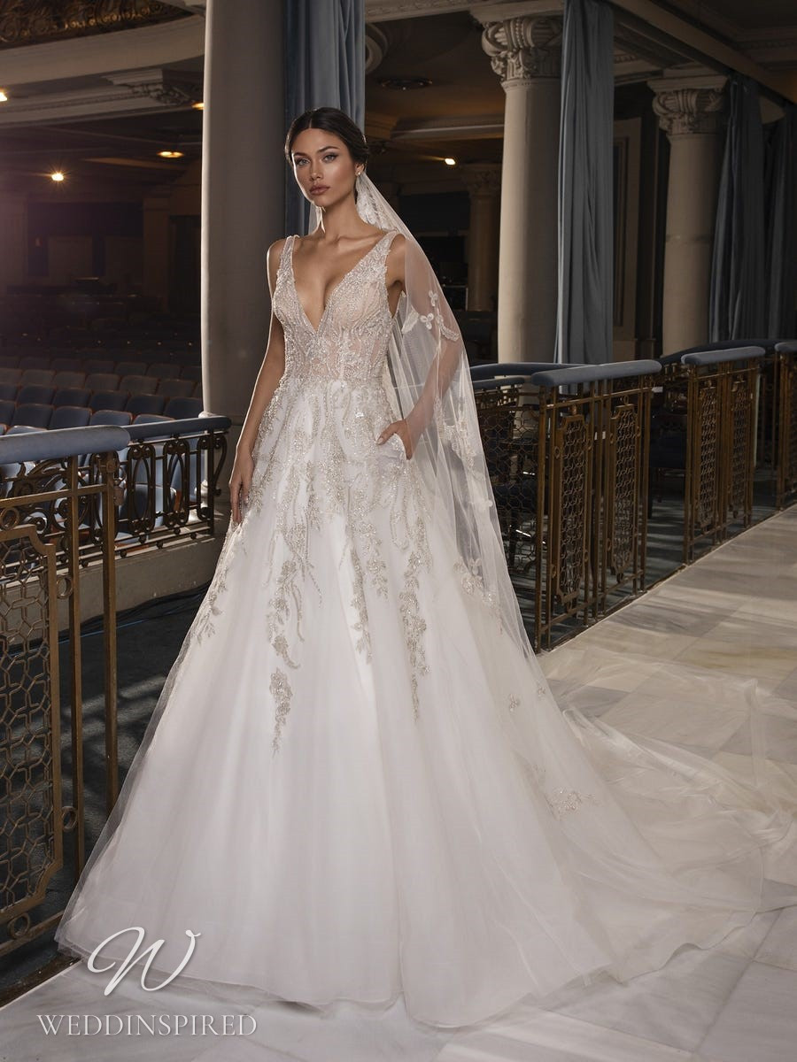 A Pronovias Privée 2021 lace and tulle A-line wedding dress with straps and a v neck