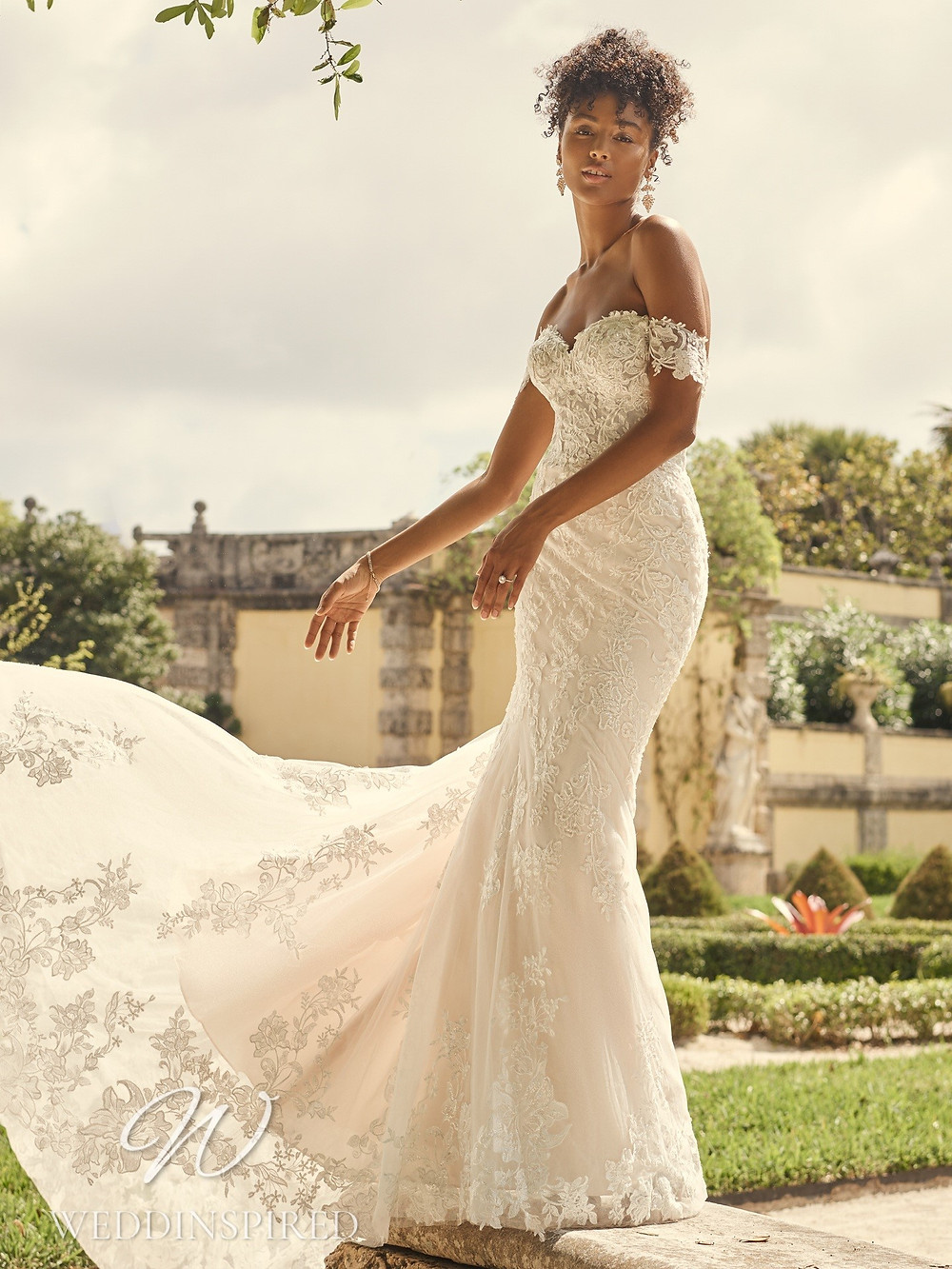 A Maggie Sottero 2021 lace off the shoulder mermaid wedding dress