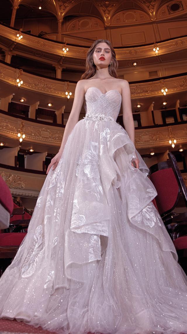 A Galia Lahav strapless flowy ball gown wedding dress with a layered skirt