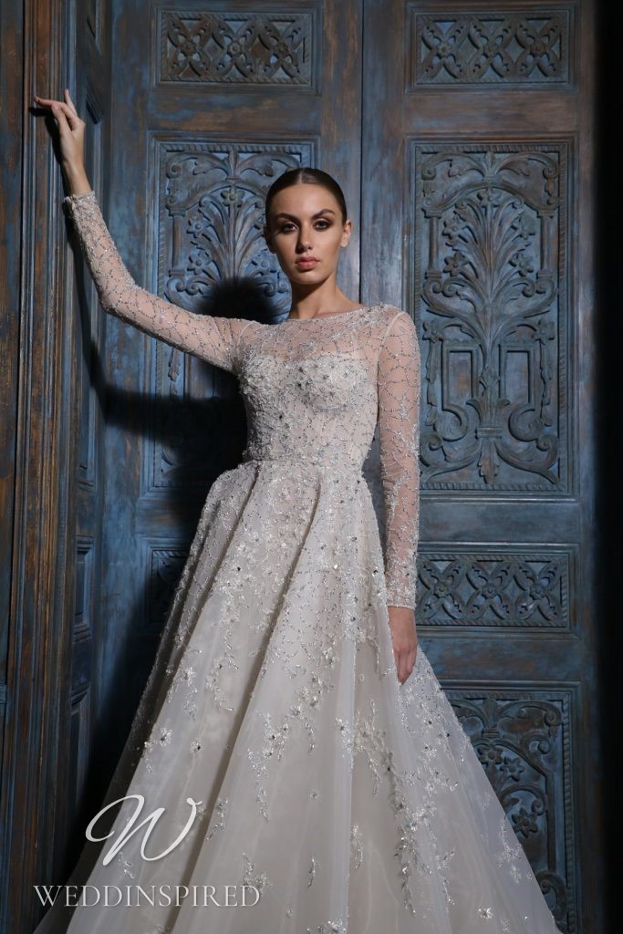 A Georges Hobeika 2021 lace princess wedding dress with long sleeves