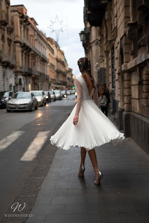 A Naviblue short tea length pleated wedding dress