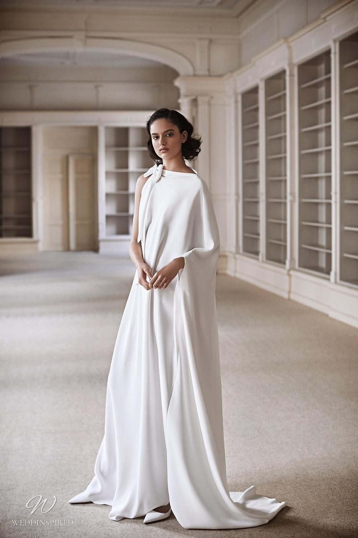 A Viktor & Rolf 2021 loose fitting sheath wedding dress with a bow