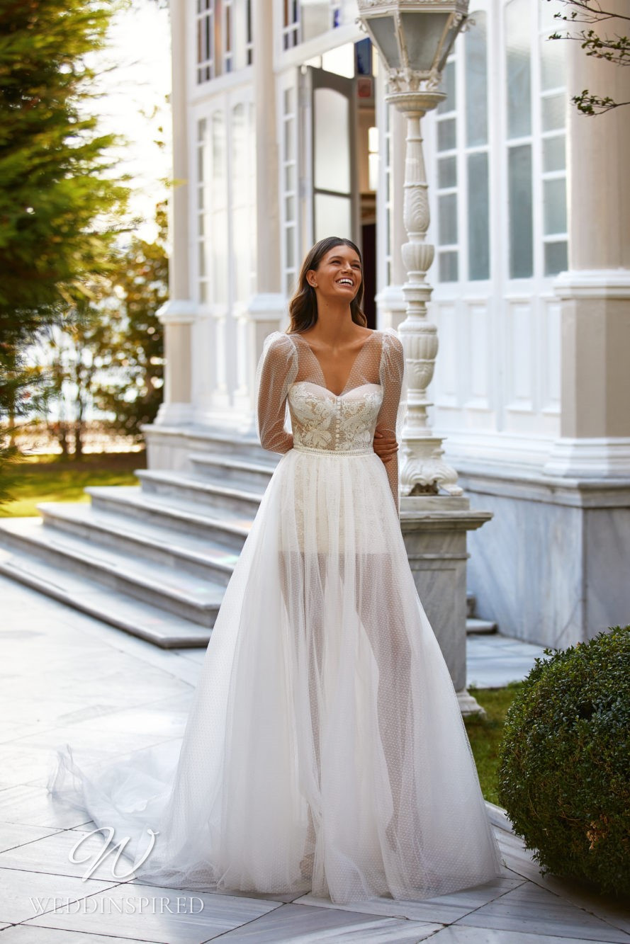 A Milla Nova 2021 ivory lace and tulle A-line wedding dress with long sleeves