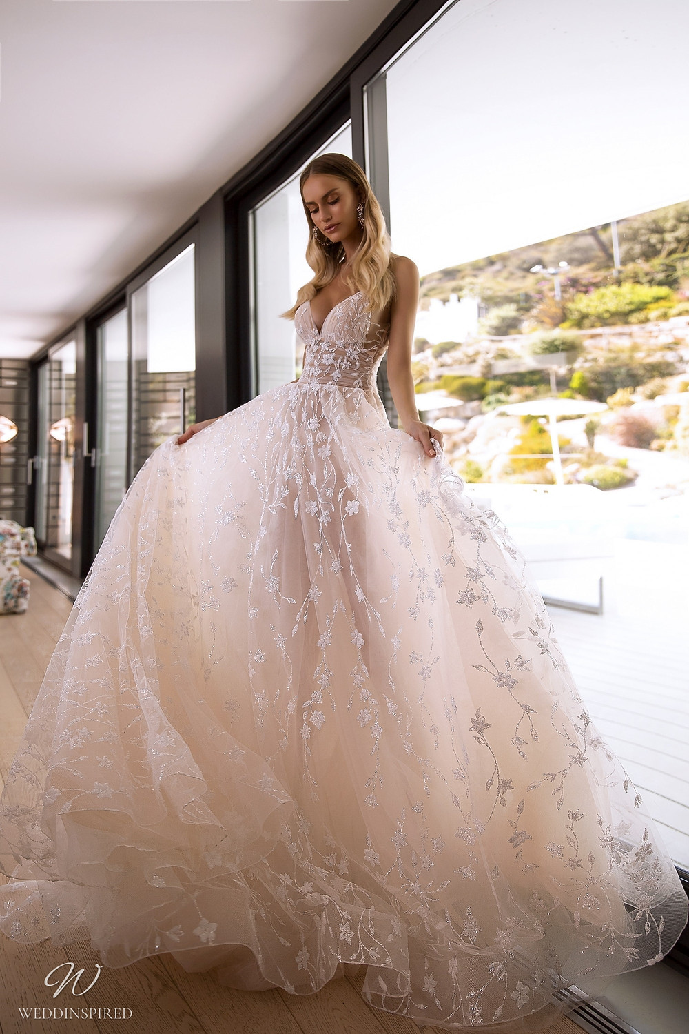 A Tina Valerdi blush tulle A-line wedding dress with lace and straps