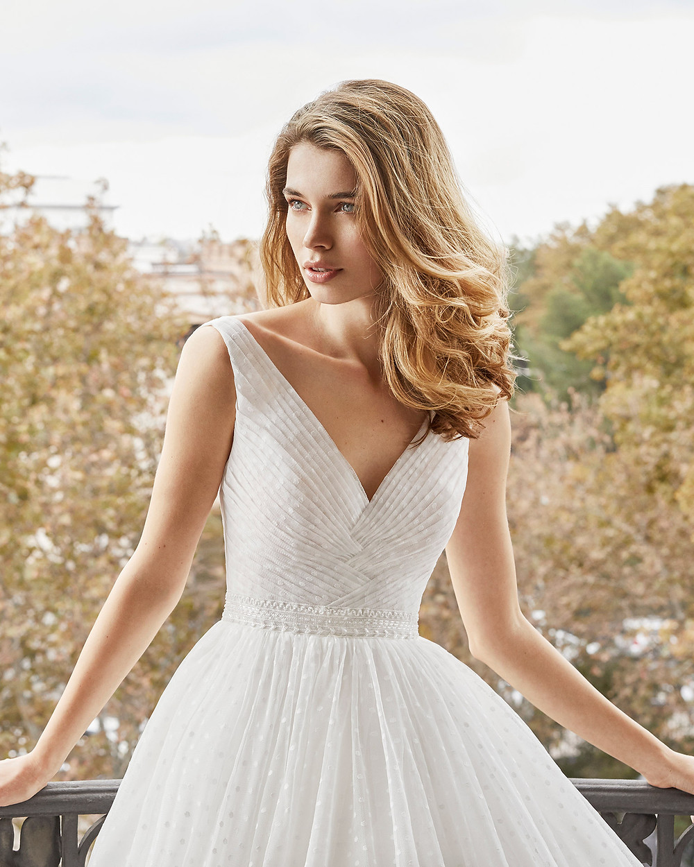 An Aire Barcelona 2020 polka dot crepe ball gown wedding dress with a v neckline