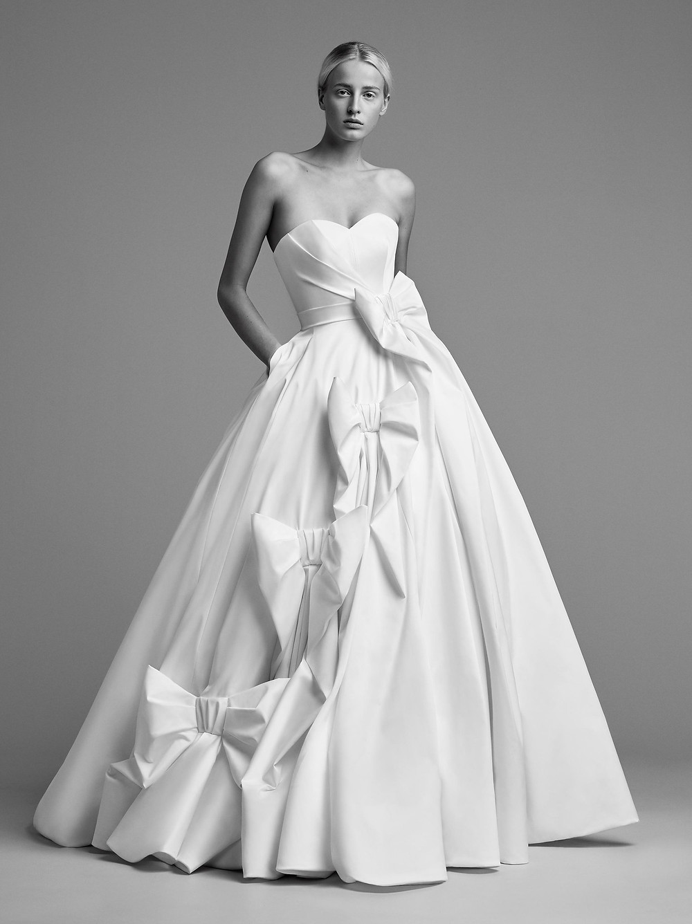 A Viktor & Rolf strapless crepe ball gown wedding dress with a sweetheart neckline and bows