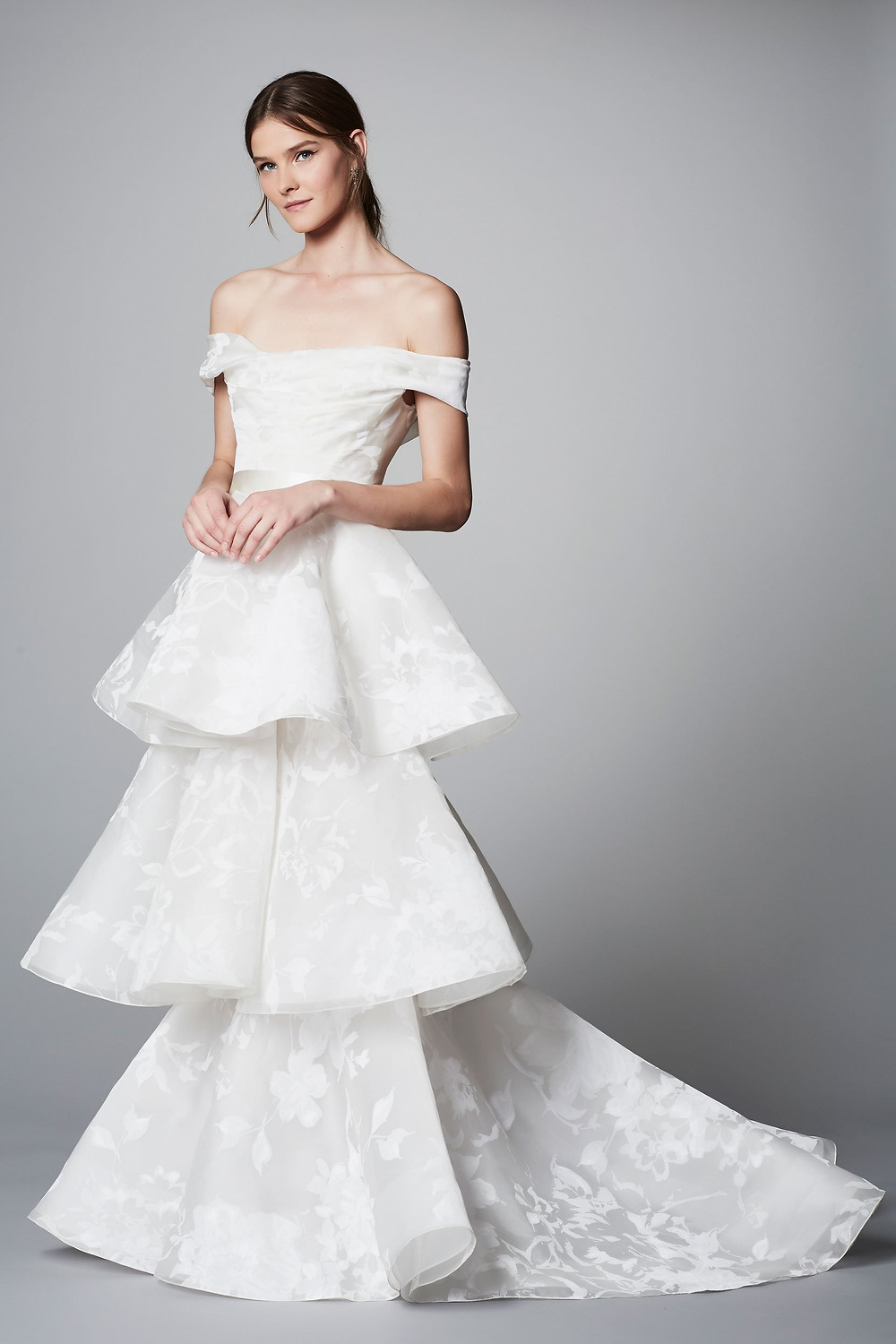 A Marchesa off the shoulder A-line wedding dress with a layered skirt
