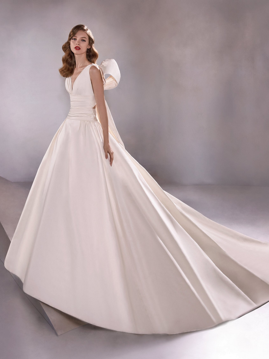 A Pronovias simple ivory silk ball gown wedding dress with a bow