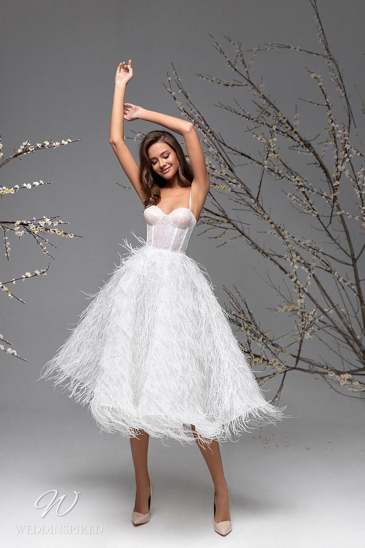 A Ricca Sposa tea length wedding dress with feathers