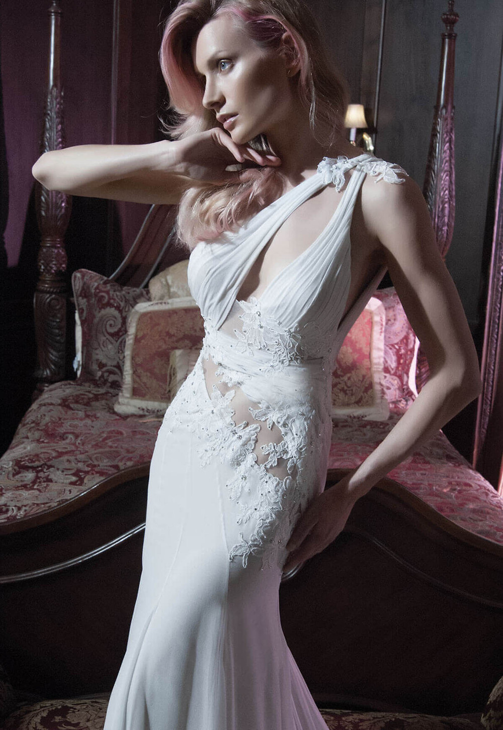 A Pnina Tornai sexy one shoulder mermaid wedding dress with floral embellishments