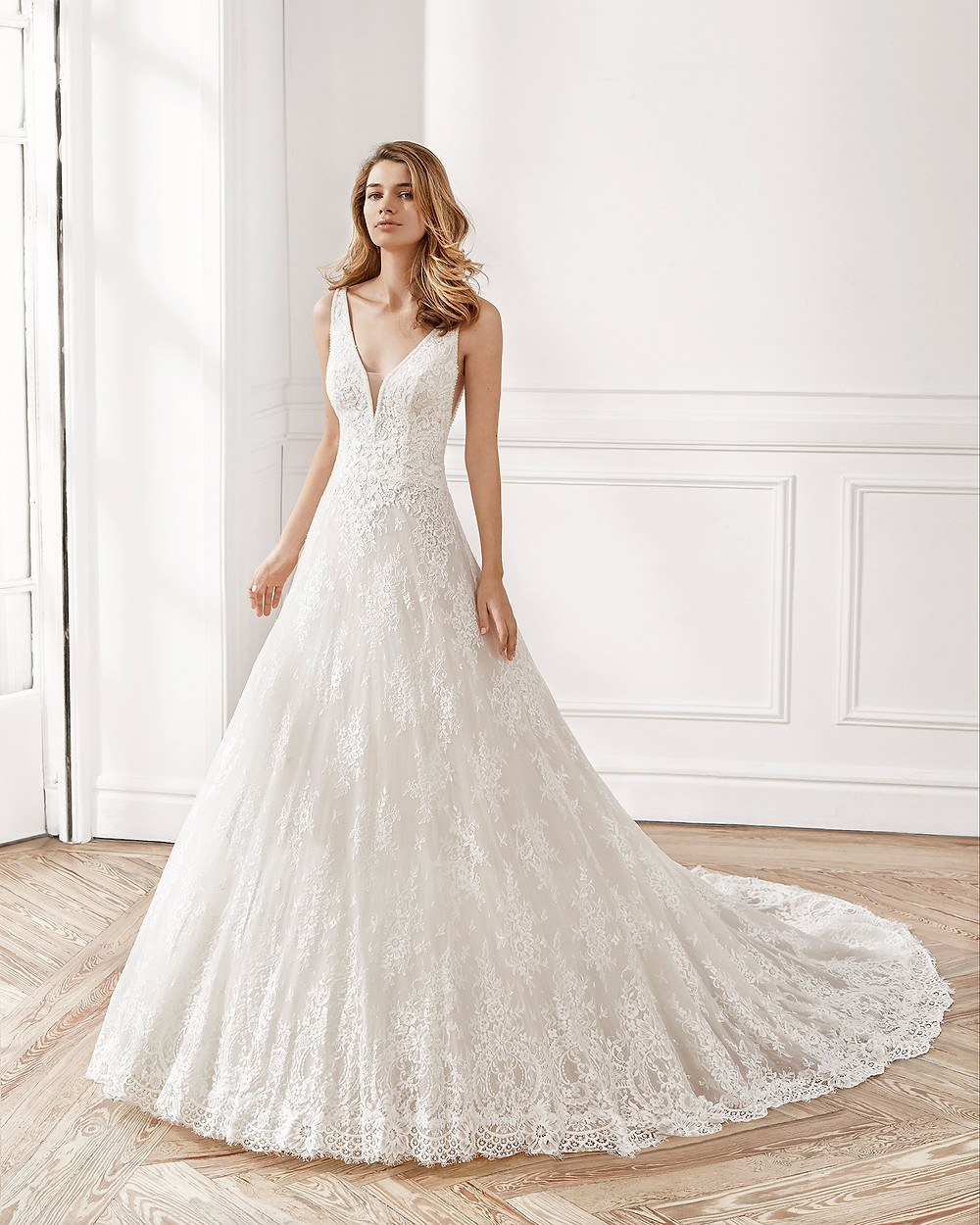 An Aire Barcelona 2020 romantic lace ball gown wedding dress with a v neckline